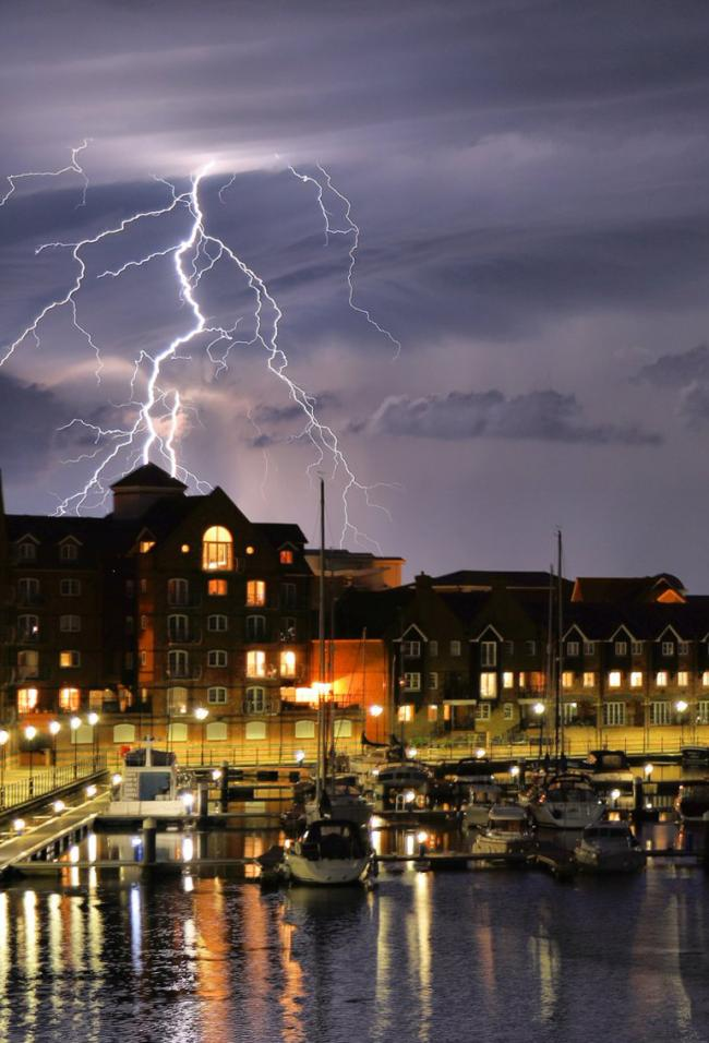 Handout photo taken with permission from the twitter feed of Mark Jarvis of a lightning storm in Eastbourne, as torrential rain and a spectacular electrical storm lashed parts of the UK overnight as unsettled weather continues to cause disruption across