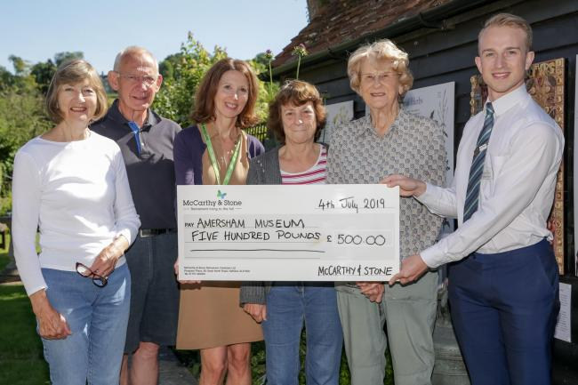 The cheque of £500 being handed over to Amersham Museum