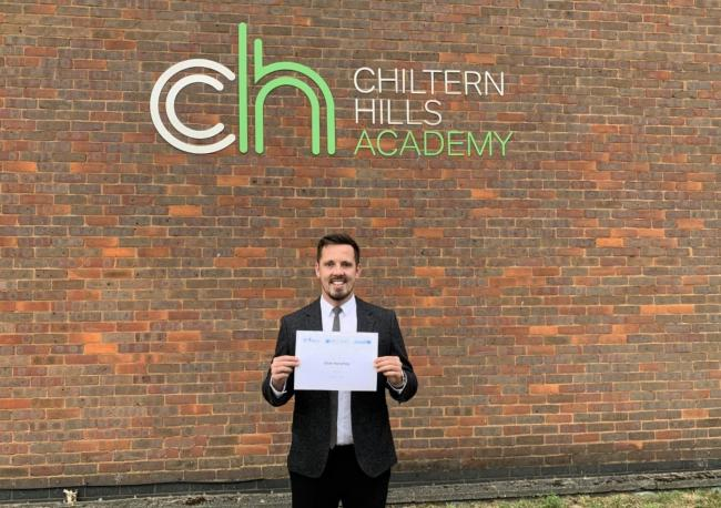 Mr Humphrey pictured with his certificate of accreditation from the United Nations.