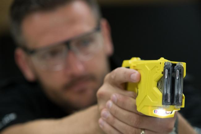 File photo of a taser being demonstrated. More than eight out of 10 police officers want to carry stun guns such as Tasers and would feel safer with the devices, a new poll suggests.