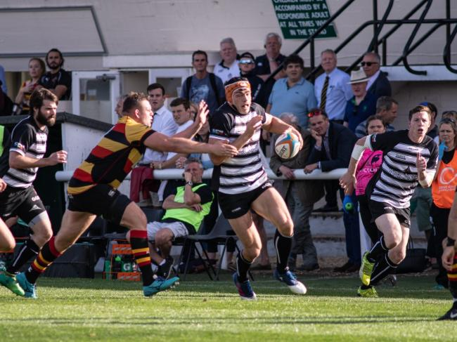 Chris Elder breaks forward for Chinnor (black and white) during the 26-14 defeat at home to Richmond in National League One on Saturday. PHOTO: David Howlett.