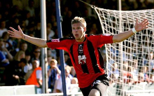 New Wycombe signing James Tunnicliffe celebrates a goal for Brighton