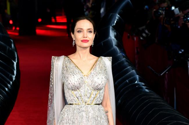 Angelina Jolie Sparkles In Silver At Maleficent Mistress Of
