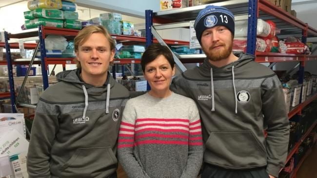 Wycombe Wanderers stars Alex Samuel (left) and Cameron Yates (right) with Steph Clay from One Can Trust (centre).