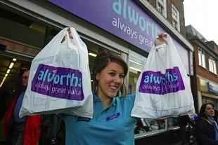 An alworths staff member at the opening of the Amersham store in November. It was confirmed today it will close next month.