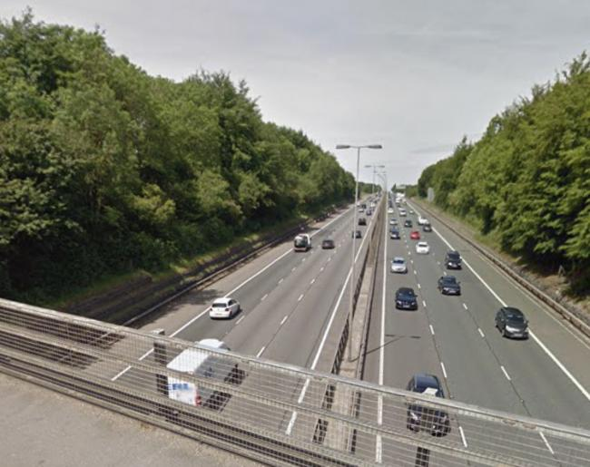 Police called to motorway bridge after man seen on wrong side of barrier