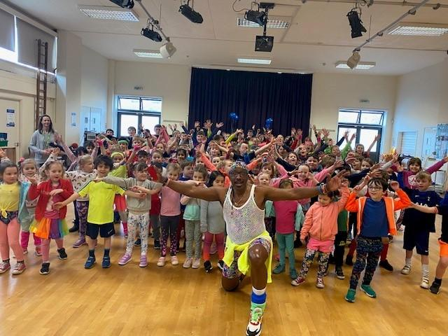 Mr Motivator and children from the school