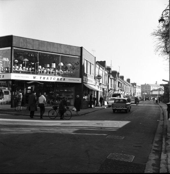 Looking NE from opposite Westbourne St, a view of Thatcher's new electrical store, on the corner of a busy Desborough Rd, High Wycombe. 1 Dec 1961