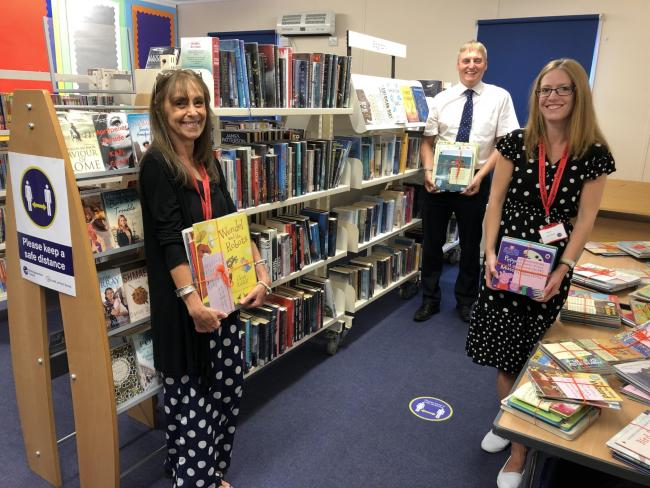 Nicky Willis (Customer Service Officer), Cllr Alex Collingwood and Michelle Sandalls (Library Manager) inside the new temporary library space in Marlow