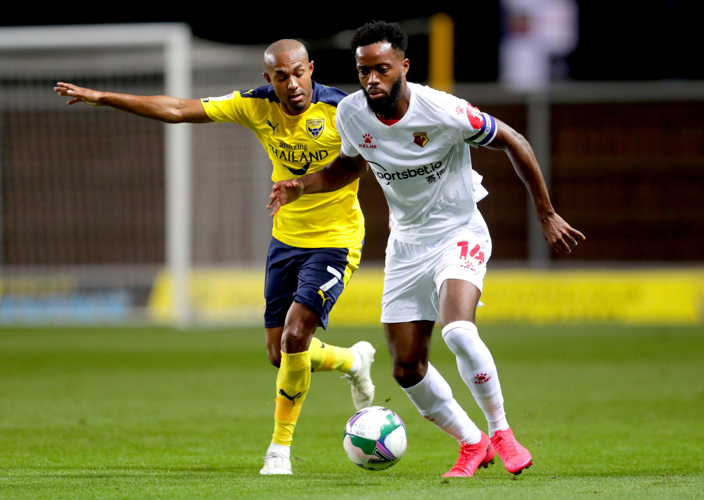 Rob Hall (left) and Watfords Nathaniel Chalobah battle for the ball during the Carabao Cup match at the Kassam Stadium (David Davis)