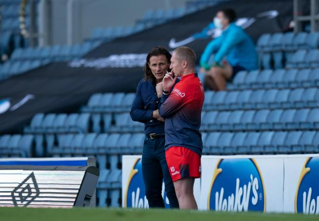 Gareth Ainsworth and Richard Dobson were in deep discussion at Ewood Park (Andy Rowland/Prime Media)