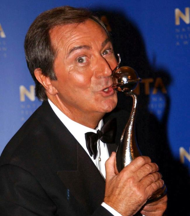 Des O'Connor in October 2001 with his Special Achievement Award at the National Television Awards (Myung Jung Kim/PA)