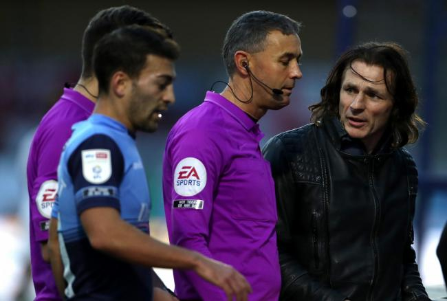 Gareth Ainsworth talking to the officials (PA)