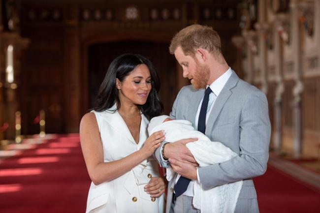 The Duke and Duchess of Sussex with their baby son Archie Harrison Mountbatten-Windsor during a photocall in St George's Hall at Windsor Castle in Berkshire (Dominic Lipinski/PA)
