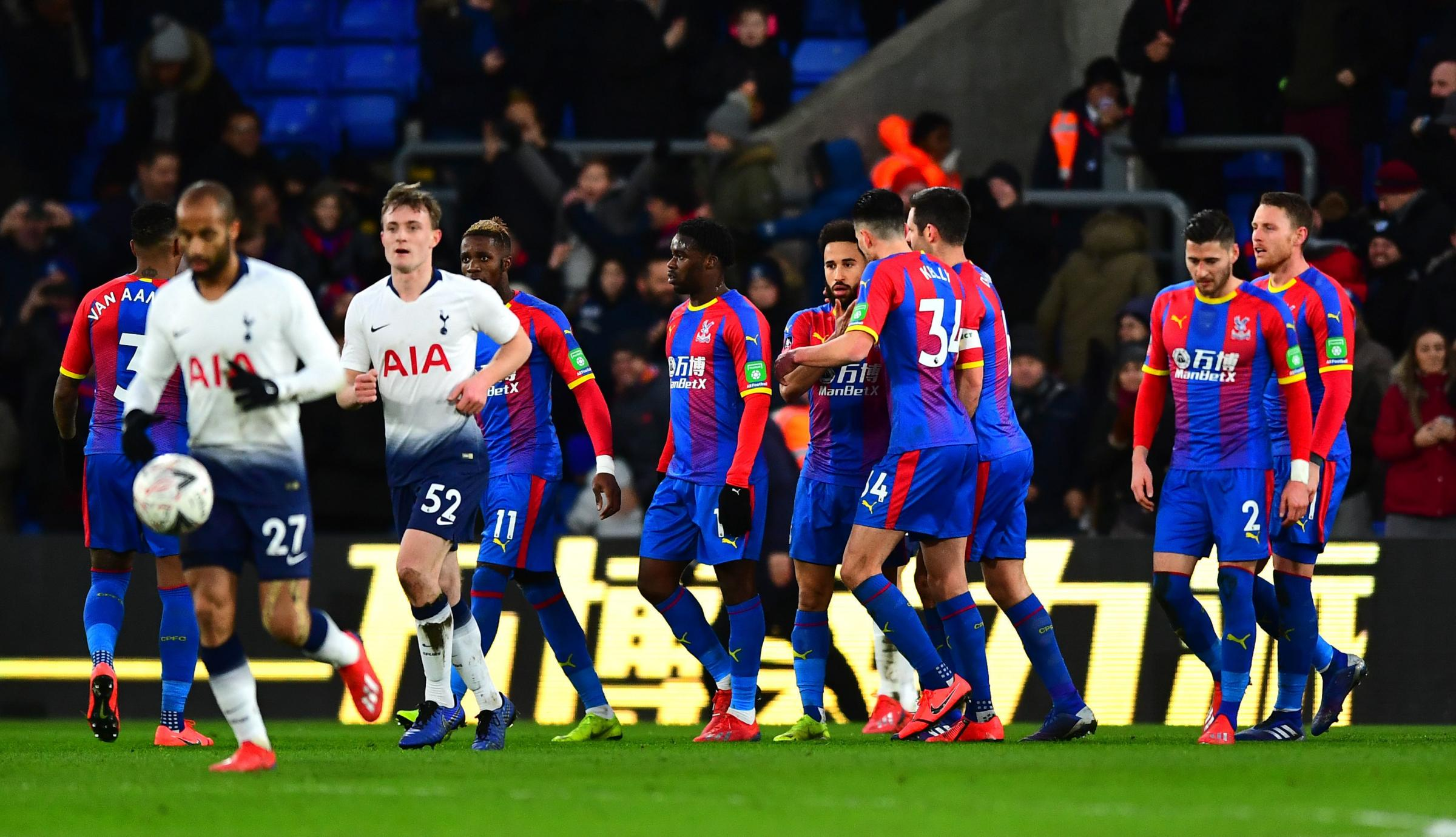Jeffrey Schlupp (centre) celebrates Andros Townsends goal against Spurs in a FA Cup match in 2019 (PA)