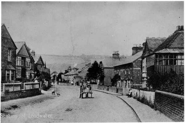 This photo is even earlier, taken circa 1905. It is looking north along Station Road and shows two men and a cart. You can still see the beautiful hillside in the distance, although the view is obscured by more trees and a block of flats on the London