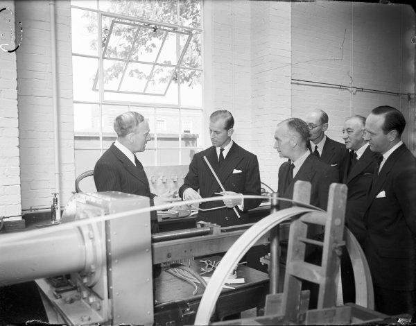 Bucks Free Press: The Duke of Edinburgh being shown wood-forming equipment during his visit to the Forest Products Research Laboratories, Princes Risborough. April 30, 1952