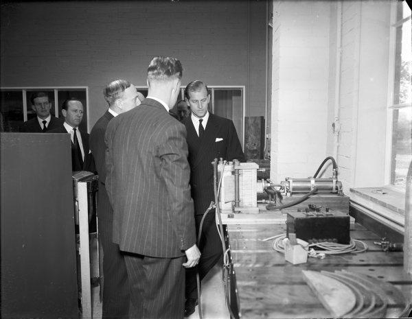 Bucks Free Press: The Duke of Edinburgh being shown laminated wood-bending techniques during his visit to the Forest Products Research Laboratories, Princes Risborough. April 30, 1952