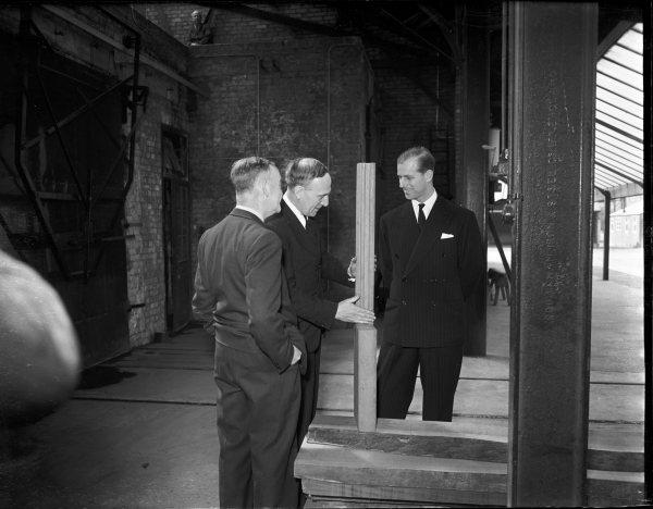 Bucks Free Press: The Duke of Edinburgh being shown a piece of kiln-dried oak during his visit to the Forest Products Research Laboratories, Princes Risborough. April 1952