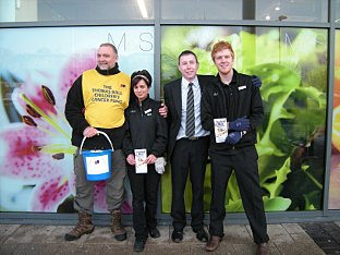 Fundraiser Gary Heawood with M&S staff outside the store