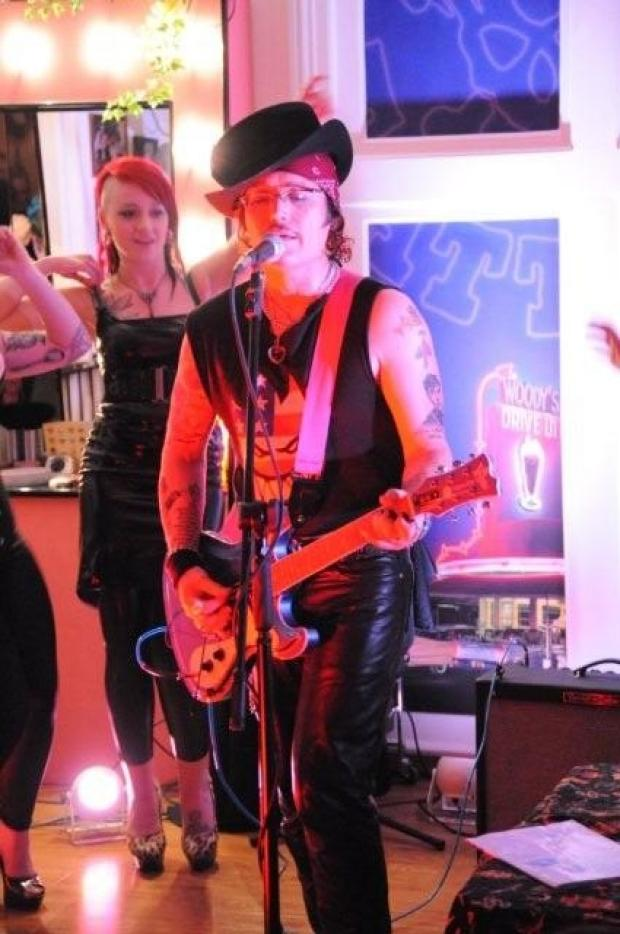 Adam Ant pictured during his set at Woody's tattoo studio in High Wycombe