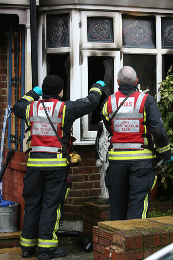 Fire investigation team outside the fire damaged house in December