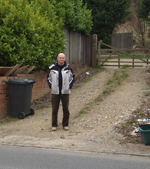 Protester Nigel Phillips at the entrance to the site on Wycombe Lane