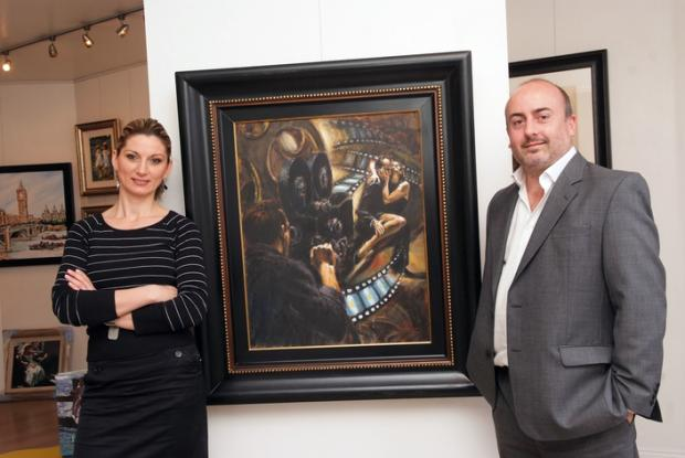 Alexandra Rosca and Paul Gray from the Lemongrove Gallery (pictured here with some of his work)