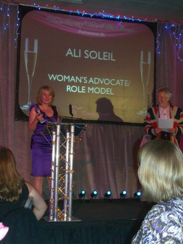 Ali Soleil accepting the award