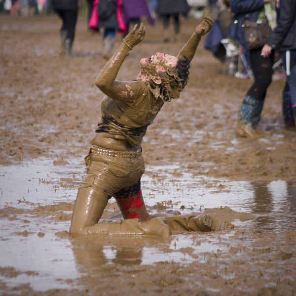 Festival goers enjoy the mud at Penn Festival. Photo by Robert Lewis
