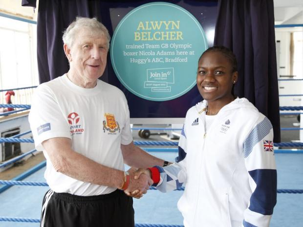 Nicola Adams helps to unveil a plaque at Huggy's for her coach Alwyn Belcher