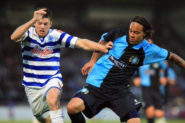 Charles Dunne, seen here challenging QPR's Jamie Mackie, has impressed in pre-season