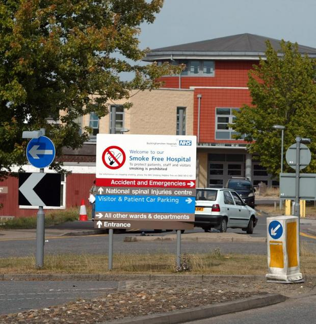 Patients left 'sitting on floor' as another surge hits hospital