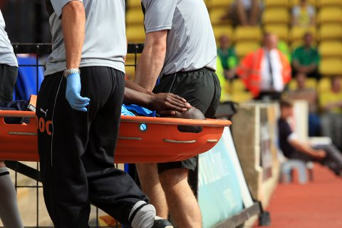 Marvin McCoy is stretchered off against Watford on Saturday
