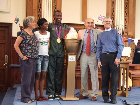 Gold medal winner drops into church
