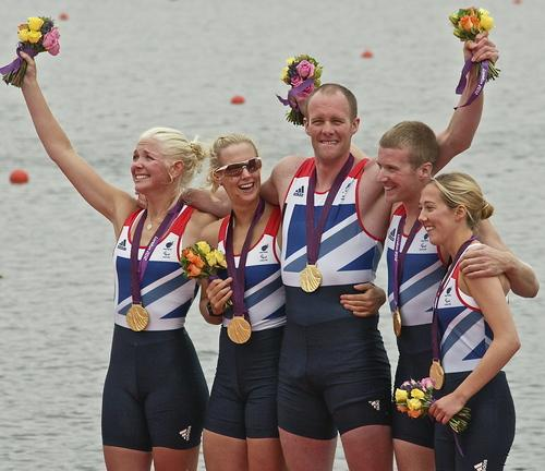 Naomi Riches, second left, celebrates her Games gold