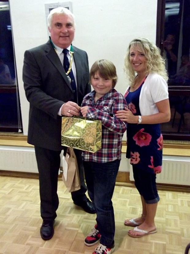 Daniel Hatfield receives award from chairman, David Brown, with mum Julie