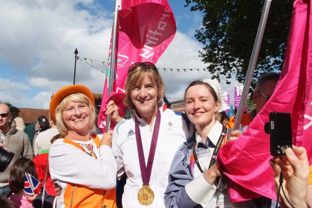 Olympic ceremony participants with gold medal winner Katherine Grainger