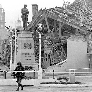 A community centre lies in ruins the morning after the IRA bombing of a Remembrance Day ceremony in the town of Enniskillen 25 years ago