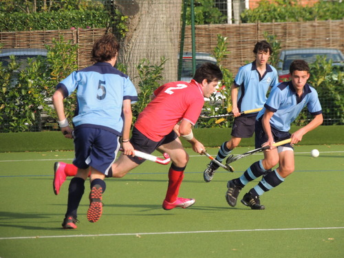 Marlow, in red, got the better of their old foes Wycombe