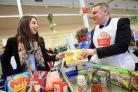 Staff at Tesco, in Shenley Road, collecting food for the campaign