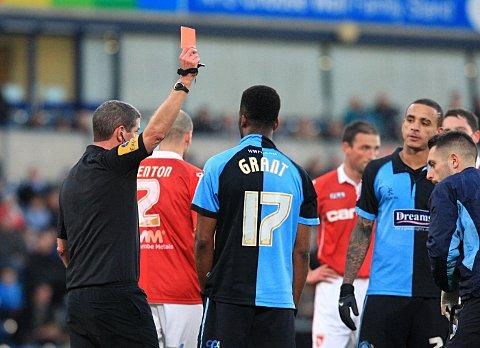 Andy D'Urso shows Joel Grant a red card