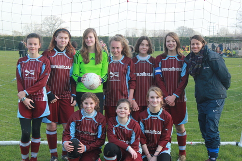 The unbeaten U14s with coach and FA Cup scorer Gemma Fraser
