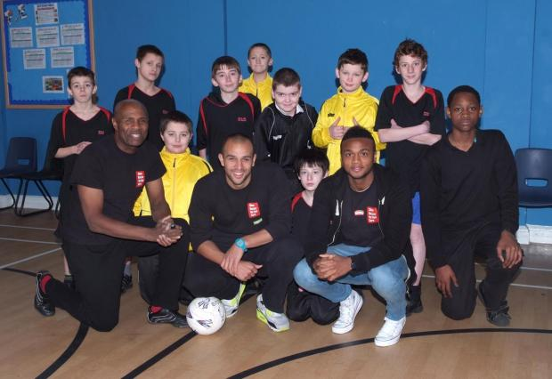 Football stars tell pupils to show racism the red card