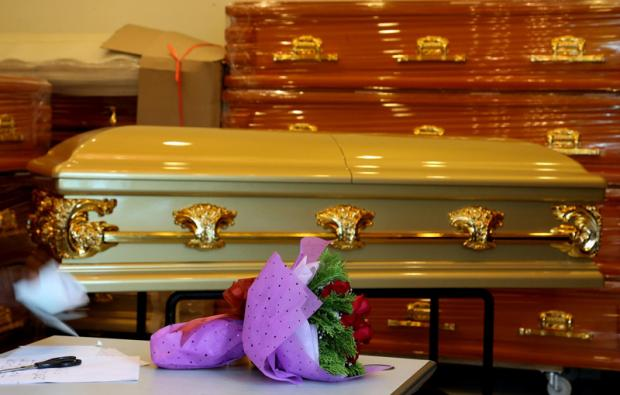 Funeral directors will disturb my children, claims resident