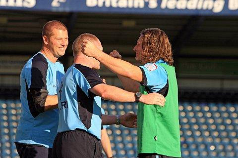 Gareth Ainsworth embraces Richard Dobson and Lee Harrison after Blues beat Torquay in October