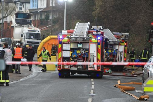 Road closures after bin lorry leak