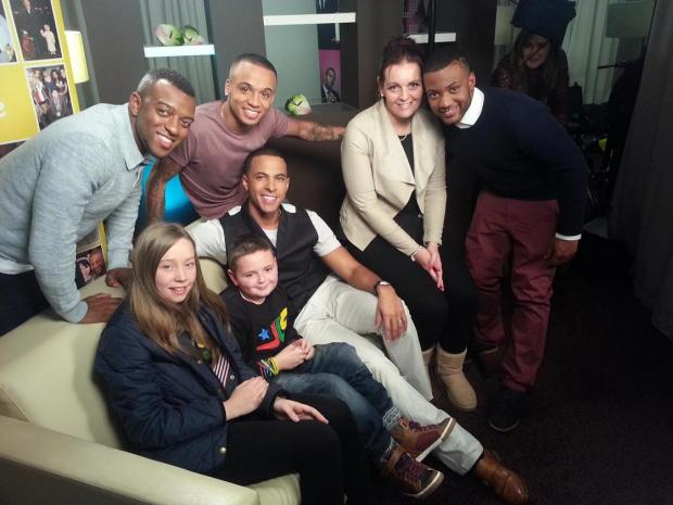 Jason, centre, and his family meet JLS
