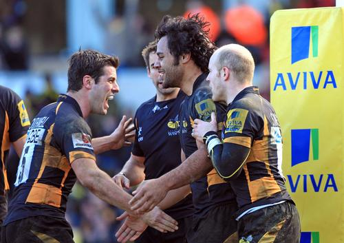 Billy Vunipola celebrates his try