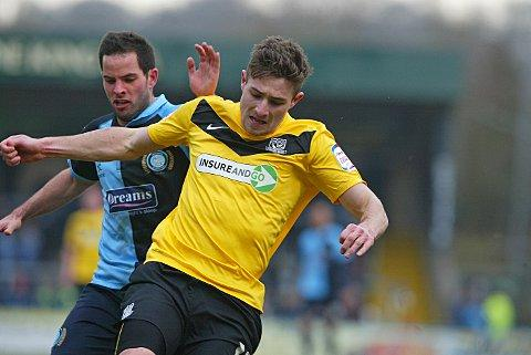 Sam Wood is kept at bay by Southend